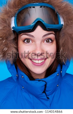 portrait of happy skier with mask - stock photo