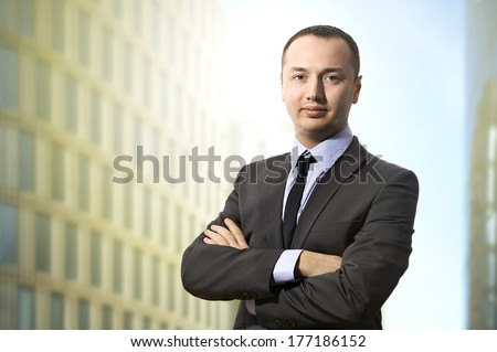 Portrait of happy smart business man - stock photo