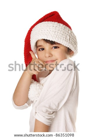 Portrait of happy smiling beautiful little boy in hat of Santa Claus isolated on white background - stock photo