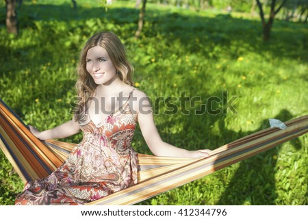 Portrait of Happy Smiling Blond Female Resting in Hummock in Spring Forest Outdoors.Horizontal Image - stock photo