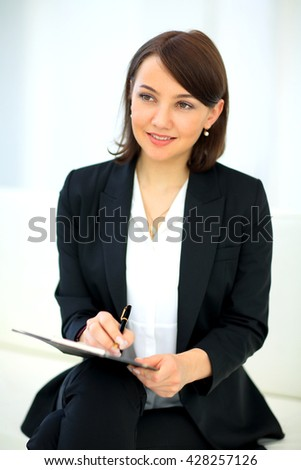 Portrait of happy smiling business woman - stock photo