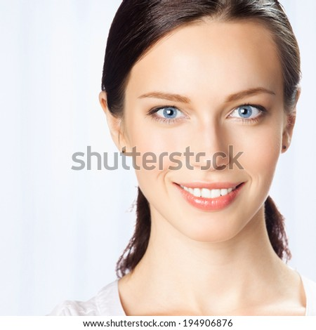 Portrait of happy smiling business woman, at office - stock photo