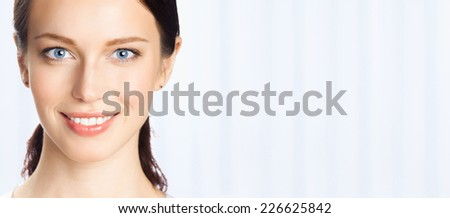 Portrait of happy smiling business woman, at office, with blank area for sign or copyspase - stock photo