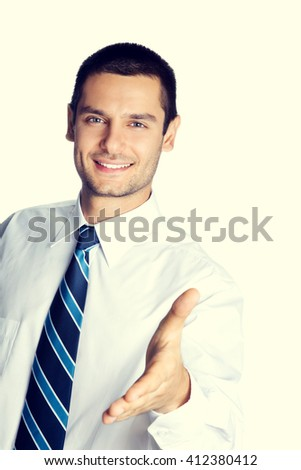 Portrait of happy smiling businessman giving hand for handshake - stock photo