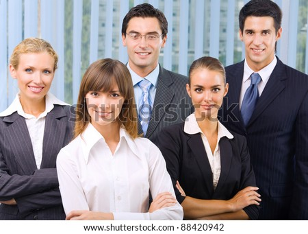 Portrait of happy smiling cheerful business team at office - stock photo