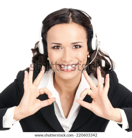 Portrait of happy smiling cheerful customer support phone operator in headset showing okay gesture, isolated over white background - stock photo