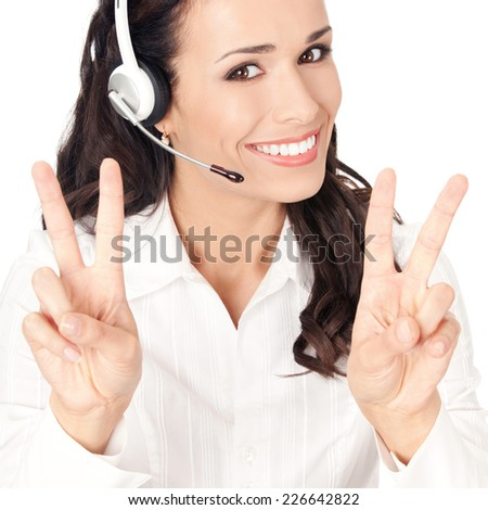 Portrait of happy smiling cheerful customer support phone operator in headset showing two fingers, isolated on white background - stock photo