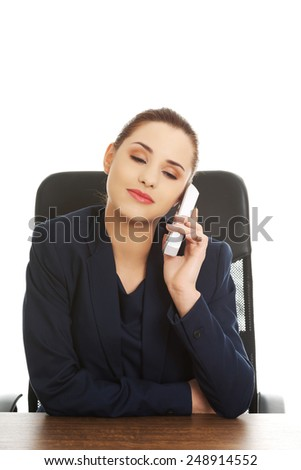 Portrait of happy smiling cheerful support phone operator with phone - stock photo