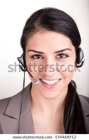 Portrait of happy smiling cheerful young support phone operator in headset isolated over white background - stock photo