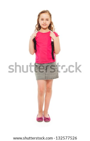 Portrait of happy, smiling, confident 9 years old girl with curly hair, wearing backpack isolated on white - full height portrait - stock photo