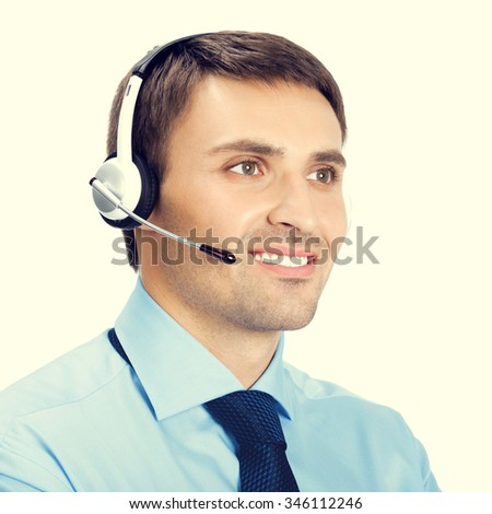 Portrait of happy smiling customer support phone operator in headset - stock photo