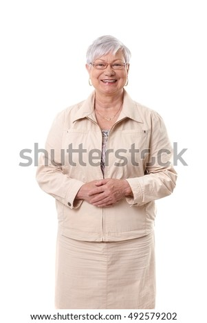 Portrait of happy smiling elderly woman over white background.