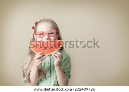 Portrait of happy smiling five years old blond caucasian child girl with watermelon - retro or vintage style photo. Careless childhood or healthy diet concept - background layout with free text space. - stock photo