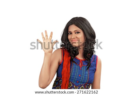 Portrait of happy smiling indian woman showing five fingers, isolated over white background - stock photo