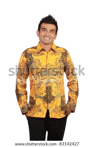 Portrait of happy smiling man wearing batik, isolated on white background - stock photo