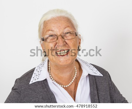 portrait of happy smiling mature woman isolated on white