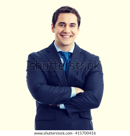 Portrait of happy smiling senior businessman in crossed arms pose