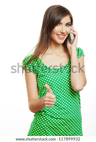 Portrait of happy smiling woman dressed in a green blouse, Isolated on white background use phone. - stock photo