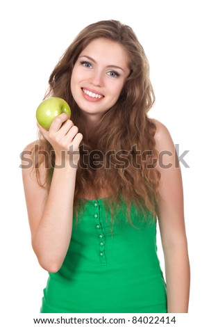 portrait of happy smiling woman hold green fresh apple in hand, with long brown curly hair - isolated on white background - stock photo