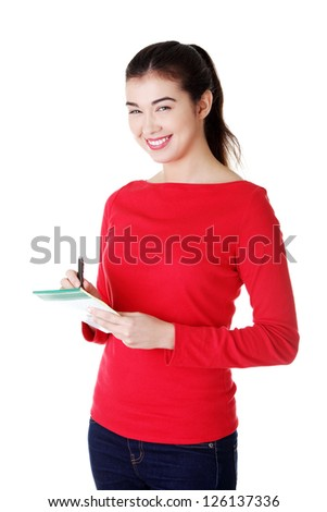 Portrait of happy smiling woman with notepad, isolated on white background