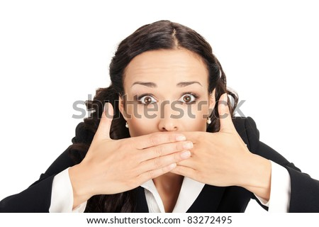 Portrait of happy smiling young business woman covering with hands her mouth, isolated on white background - stock photo