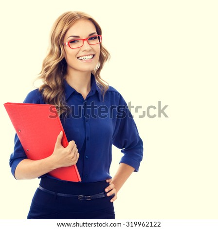 Portrait of happy smiling young cheerful businesswoman in blue clothing with red folder - stock photo