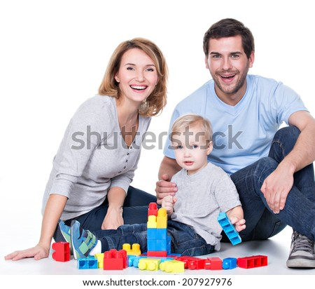 Portrait of happy smiling young parents playing with a baby - isolated on white. - stock photo