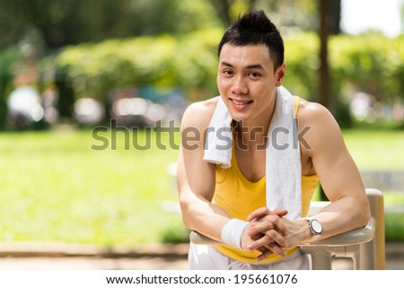 Portrait of happy sportsman resting after training - stock photo