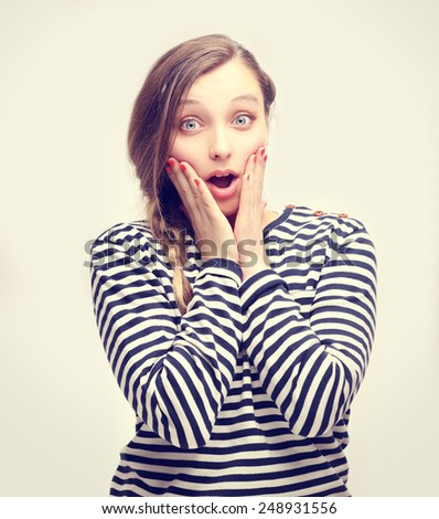 Portrait of happy surprised girl. - stock photo