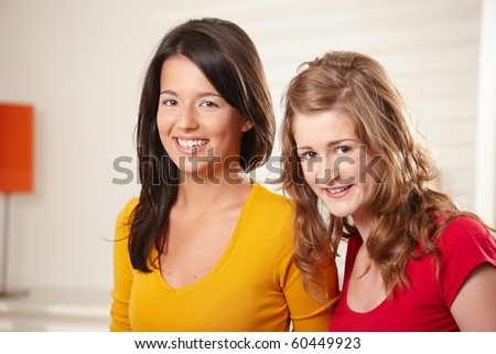 Portrait of happy teenage girls smiling together looking at camera. - stock photo