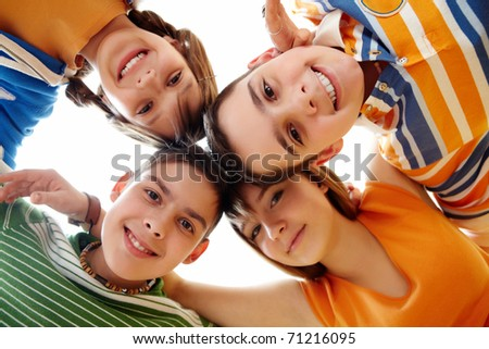 Portrait of happy teens looking at camera with smiles