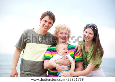 portrait of happy three generation family - stock photo