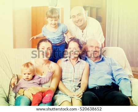 Portrait of happy three generations family with little baby