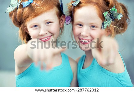 Portrait of happy twins smiling