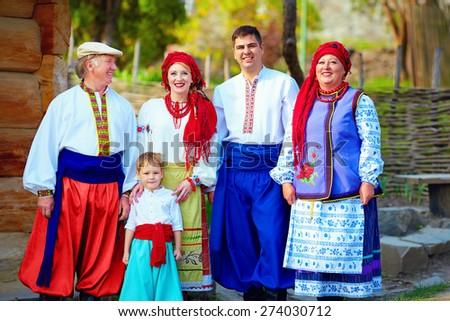 portrait of happy ukrainian family in traditional costumes - stock photo