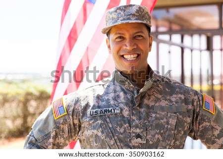 portrait of happy us army soldier outdoors - stock photo