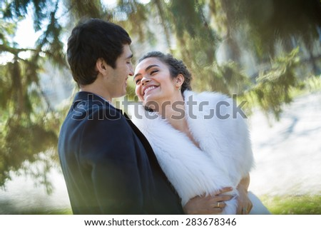 Portrait of happy wedding couple outdoors
