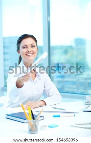 Portrait of happy woman giving application to conductor - stock photo