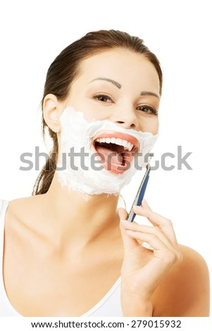 Portrait of happy woman shaving beard.