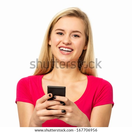 Portrait of happy woman text messaging through smart phone against white background. Horizontal shot.