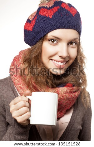 Portrait of happy woman wearing woolen accessories holding white cap, not isolated on white background - stock photo