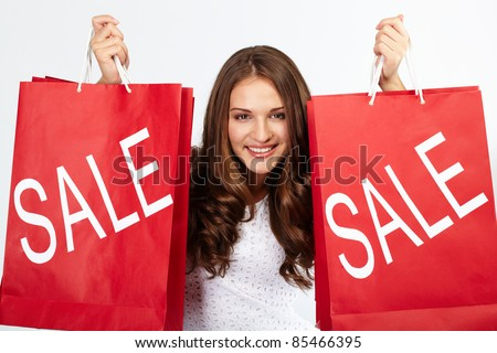 Portrait of happy woman with purchases from sale - stock photo