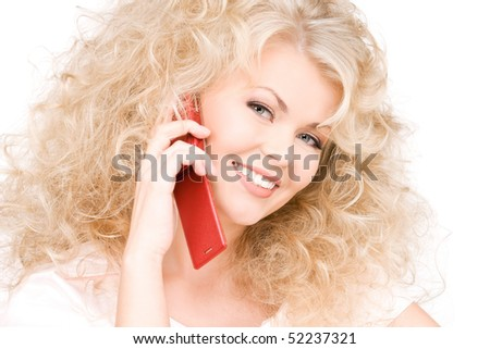 portrait of happy woman with red phone