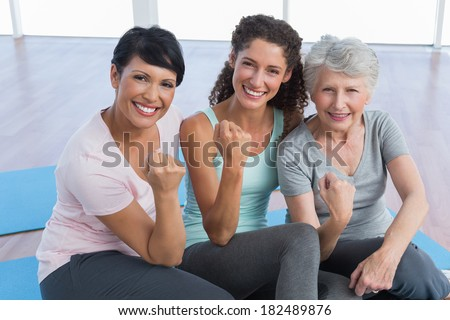 Portrait of happy women sitting in the yoga class - stock photo