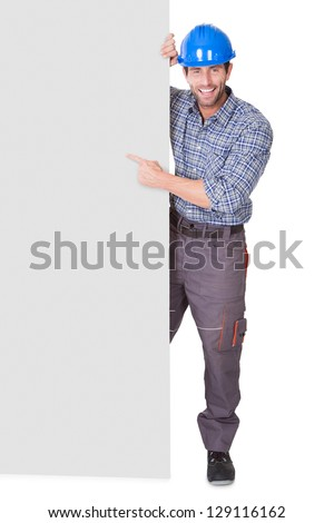 Portrait of happy worker presenting empty banner. Isolated on white - stock photo