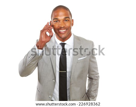 Portrait of happy young African American businessman using mobile phone over white background - stock photo
