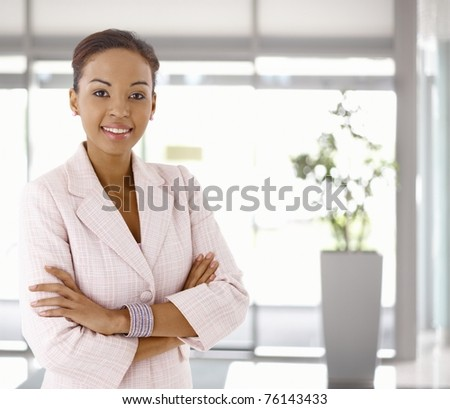 Portrait of happy young afro-american woman, looking at camera, smiling.?