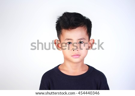 Portrait of happy young Asian boy smiling - stock photo