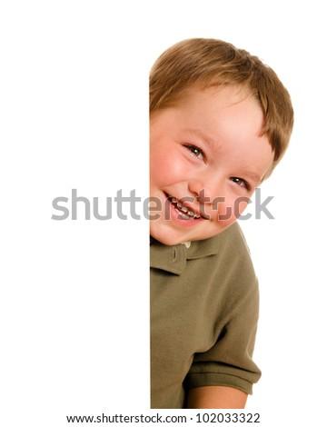 Portrait of happy young boy child peeking around corner isolated on white - stock photo