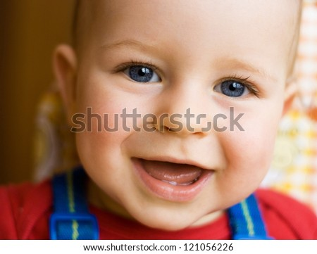 Portrait of happy young boy smiling - stock photo